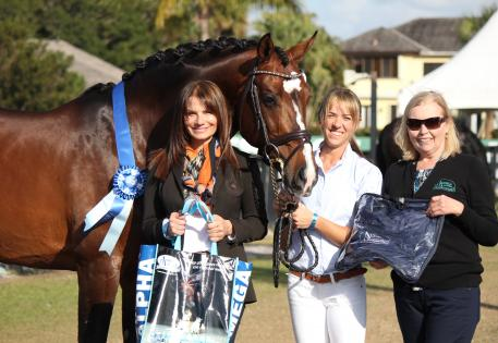 The Omega Alpha Healthy Horse, Abacus, stands (from left to right) with his owner Carol Cohen, his rider Hannah Michaels, and Patti Hanco of Omega Alpha Pharmaceuticals, Inc.