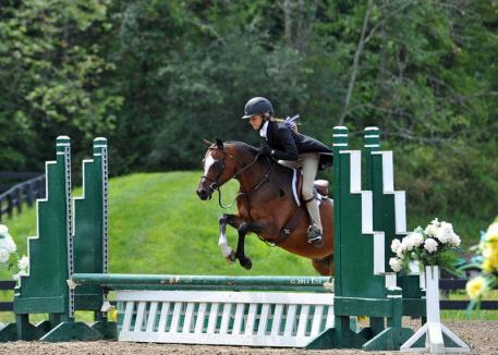 Abigail Tinsley and In the Game had their game faces on this weekend, riding to Overall Grand Champion at the Eaton & Berube Children's Hunter Pony Finals presented by Mona's Monograms at HITS Saugerties. ©ESI Photography