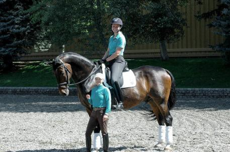 """""""Premier Equestrians"""" Debbie McDonald (front) and Adrienne Lyle, riding Wizard, will be available to meet and take """"seflies"""" with at the Premier Equestrian booth at the 2015 Reem Acra FEI World Cup Dressage"""