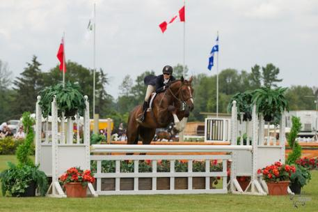 Ainsley Vince of Burlington, ON, and Magic Show, owned by Knightwood Stables, on their way to victory in the 0,000 Canadian Hunter Derby at the Ottawa International at Wesley Clover Parks on Sunday, June 21. (Photo: Ben Radvanyi Photography)