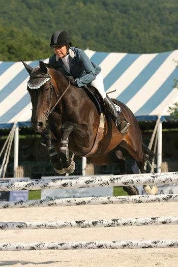 Alissa Kinsey closed out the 2014 Vermont Summer Festival in East Dorset, VT, by winning the 5,000 Child/Adult Jumper Classic, presented by Ariat, on August 10 with Grisset.  Photo by David Mullinix Photography