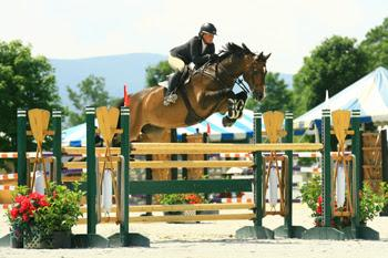 Amanda Flint topped the 0,000 Sir Ruly, Inc., Open Jumper Awards, to claim a $5,000 bonus at the 2014 Vermont Summer Festival in East Dorset, VT. Photo by David Mullinix Photography