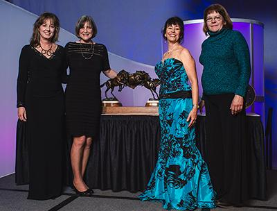 Left to right: Lisa Duncan, Registrar, American Saddlebred Registry, Lynn Coakley, EQUUS Foundation President, Kathie Dunn Jacobsen, ASHA EWC Chair and Karen Medicus, ASHA EWC Vice Chair. Photo by Adam Brennan - www.picturesbyab.com