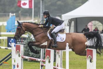 Amy Millar guides her new mount, Heros, to victory in the $50,000 Zucarlos Grand Prix, presented by Kubota Canada and Stewart's Equipment, on August 16 at the CSI2* Orangeville Show Jumping Tournament in Orangeville, ON. Photo by Ben Radvanyi Photography