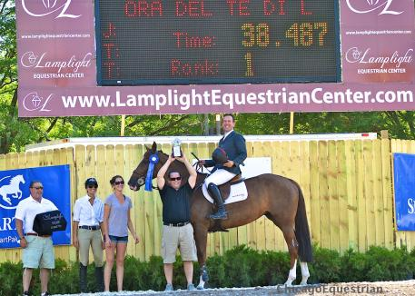 Ecstatic owners receive the award with Andrew Kocher and Ora Del Te Di La San Giorgio for the win in the $75,000 Grand Prix and Equifest I.