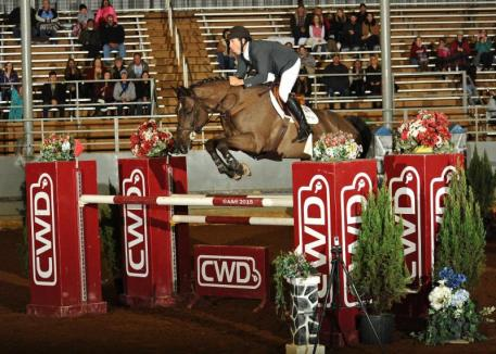 Andy Kocher and Land Rebel sail over the CWD oxer on their way to the win Saturday night.