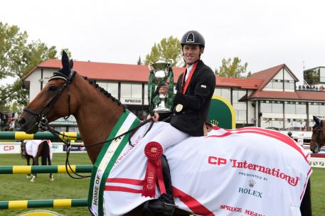 """Scott Brash with the Rolex Grand Slam Trophy on his horse """"Hello Sanctos"""", the first rider ever to win the Rolex Grand Slam of Show Jumping"""