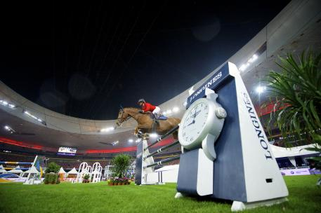 French rider, Penelope Leprevost, at the Longines Equestrian Beijing Masters in 2014. This year the floodlit jumping class on Saturday evening will be staged as a team competition.