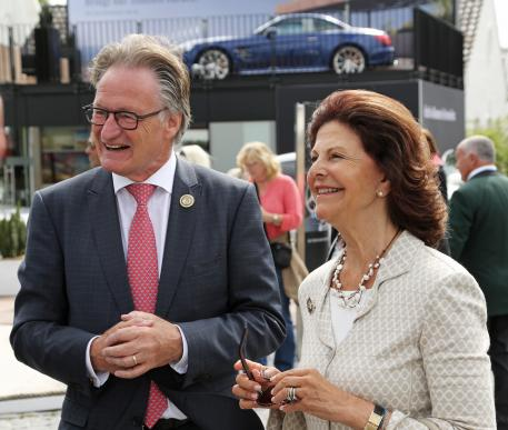her Majesty Queen Silvia of Sweden together with the Chairman of the Aachen-Laurensberger Rennverein e.V., Frank Kemperman.