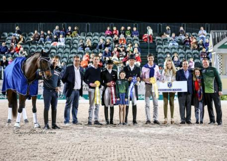 """The participants from the 2017 Palm Beach Dressage Derby following the exhibition during the """"Friday Night Stars"""" Grand Prix Freestyle CDI-W."""