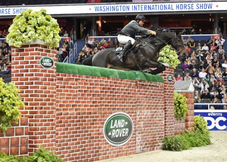 """Aaron Vale and Finou 4 cleared 6'11 1/2"""" to win the $25,000 Land Rover Puissance. (Photo: Shawn McMillen Photography)"""