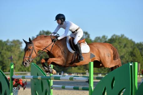 Abigail McArdle and Cosma 20 on their way to a 5,000 Brook Ledge Open Jumper Prix win at HITS Culpeper Winston National.