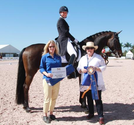 Adrienne Lyle wins the Accuhorsemat Accuracy Award at the Adequan Global Dressage Festival. From left to right: Colleen Elliot of Acuswede, Adrienne Lyle on Horizon, and Horizon's owner Betsy Juliano