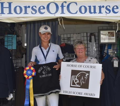 The Horse of Course CEO, Beth Haist awards Adrienne Lyle The Horse of Course High Score Award Week 10 of the Adequan Global Dressage Festival.