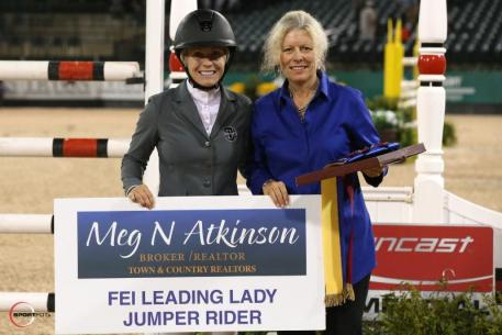 Amanda Derbyshire accepts the FEI Leading Lady Jumper Rider Award presented by Meg Atkinson of Town & Country Realtors.