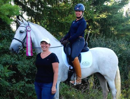 : Custom Saddlery MVR Award winner Amanda Johnson on Dulcineya, with Dulcineya's owner Kimberly David (front) (Photo courtesy of Kimberly David)