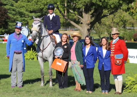 "Andres Rodriguez and SF Ariantha accept the Equis Boutique ""Best Presented Horse"" Award from Alex West of Equis, ringmasters Pedro Cebulka and Alan Keeley, Barbara Lang, and JustWorld International representatives Amber Warren and Molly McDougall at The American Gold Cup at Old Salem Farm."