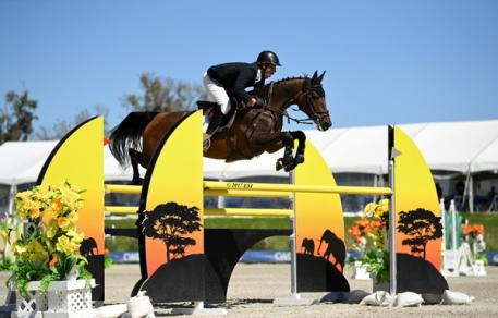 Andy Kocher and Ciana on their way to a $50,000 FEI KindredBio Grand Prix win.