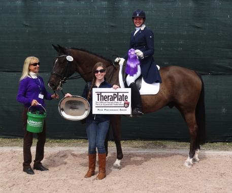 Unico G, owned and ridden by Anna Marek with trainer Anne Gribbons (left), won the TheraPlate Peak Performance Award at the Adequan Global Dressage Festival