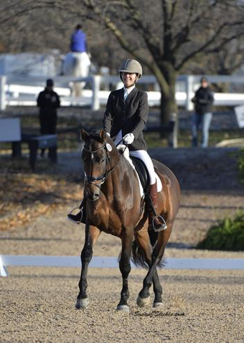 Ashlee Watts was all smiles as she trotted to victory with Hampton in the Training Level Adult Amateur Championship.