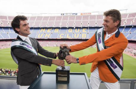 This could get messy! Sydney 2000 Olympic Jumping gold medallist and current World European champion Jeroen Dubbeldam (NED), right, and Sergio Álvarez Moya (ESP) wrestle with the Furusiyya trophy at FC Barcelona's iconic Camp Nou stadium in the countdown to the Furusiyya FEI Nations Cup™ Jumping Final at the neighbouring Real Club De Polo de Barcelona (24-27 September).(FEI/Dan Rowley)