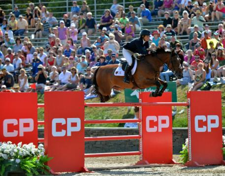 Beezie Madden, of Cazenovia, New York, and Abigail Wexner's Simon claim the CP  Million Grand Prix FEI CSI-5*, presented by Wells Fargo on September 6, 2015 at HITS-on-the-Hudson in Saugerties, New York.