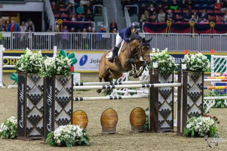Four-time U.S. Olympic medalist Beezie Madden (USA) won the $35,000 Brickenden Trophy riding Coach on Thursday, November 9, at the CSI4*-W Royal Horse Show in Toronto, ON
