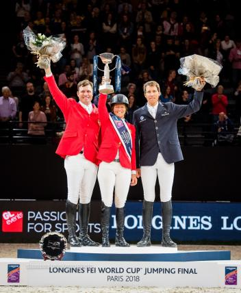 Celebrating victory on the podium - (L-R) Devin Ryan (USA), Beezie Madden (USA) and Henrik von Eckermann (SWE)