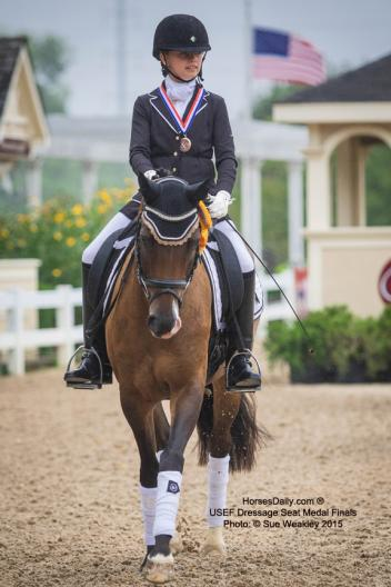 Camille Molten on Mom's Little Luluat the USEF Dressage Seat Medal Finals
