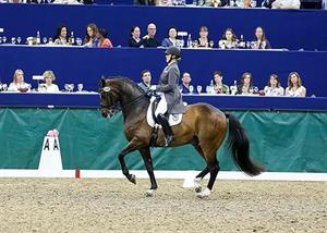 Canada's Karen Pavicic and Don Daiquiri on their way to winning the Grand Prix