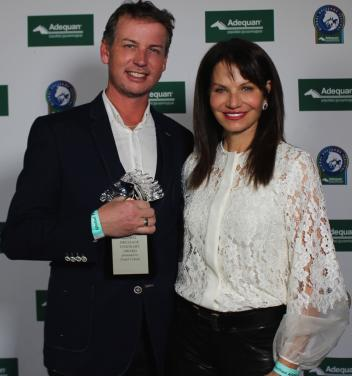 Carol Cohen (right) presents the Global Dressage Visionary Award to Olympian Carl Hester (left) at the Adequan Global Dressage Festival
