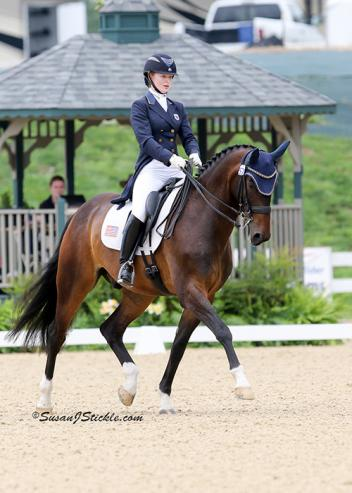 Catherine Chamberlain and Avesto van Weltevreden win the Young Rider division at the U.S. Dressage Festival of Champions