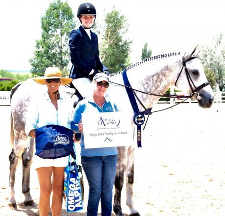 Ceto II, trained by Julie Luzicka (right) and ridden by Hannah Wiggins, wins the Omega Alpha Healthy Horse Award at the Summer in the Rockies show series at the Colorado Horse Park