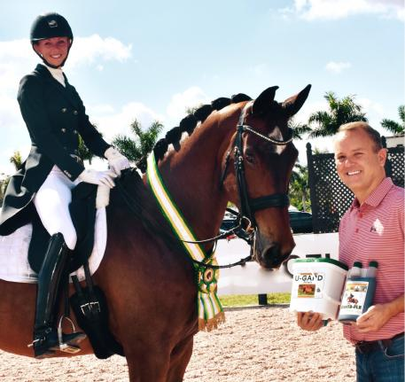 Corta-Flx® representative Charlie O'Hara presented Laura Graves' horse Verdades with the Corta-Flx® Sport Horse of the Week Award at the AGDF