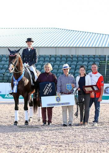 Charlotte Jorst and Kastel's Nintendo in their winning presentation with judge Kristi Wysocki, Javier Bacariza of Yeguada de Ymas, Cora Causemann of AGDF, and Allyn Mann of Adequan. grand prix special, GDF week 3 2017