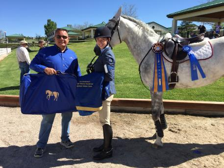 Thomas Willetto congratulates Chelsea Luedke and McGinty's Irish Rose on winning the Open Novice A