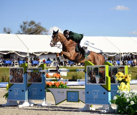 Cian O'Connor and Seringat on their way to a 00,000 City of Ocala Grand Prix win.