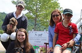 Emma, Lindsay and Avery Schauder with their mother and trainer Christina at the Country Lane Farm setup at the Vermont Summer Festival in East Dorset, VT. (Photo: Lindsay Brock for Jump Media)