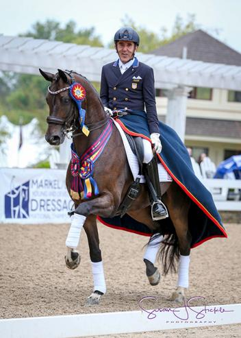 Dr. Cesar Parra clinched the Championship first place title aboard Fashion Designer OLD at the Lamplight Equestrian Center in Wayne, IL