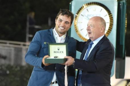 Daniel Bluman recieves his Rolex watch from  Stewart Wicht, CEO & President of Rolex USA. Photo by Josh Walker for The Chronicle of the Horse