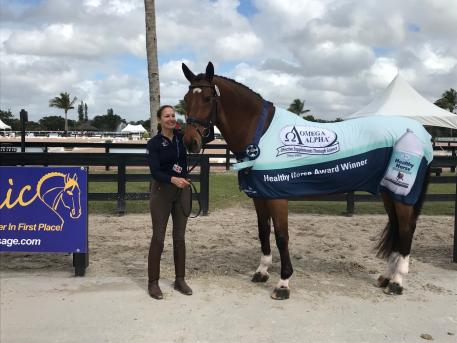 Debbie Hill and Cartier receiving their Omega Alpha Healthy Horse Award during week five of the Adequan Global Dressage Festival