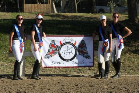 "Laurel Kerner of Ramona, Calif. (far right) joined her ""Devil's Angels"" teammates to celebrate their win at the CDS Junior Young Rider Championships – Southern Region. Photo courtesy of Laurel Kerner."