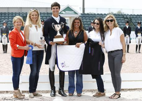 Terri Kane of Diamante Farms (far left), a presenting sponsor of the Florida International Youth Dressage Championships, joins in awarding Young Rider champion Juan Matute Jr. (third from left)