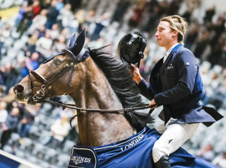 Sweden's Douglas Lindelöw and the brilliant bay gelding Zacramento proudly take their victory lap at the opening leg of the Longines FEI Jumping World Cup™ 2018/2019 Western European League in Oslo (NOR) today. (FEI/Satu Pirinen)