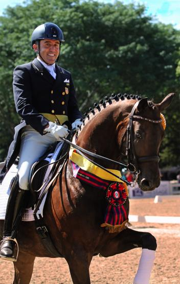 Dr. Cesar Parra with Fashion Designer OLD took third place overall in the Markel/USEF Developing Prix St. Georges Final