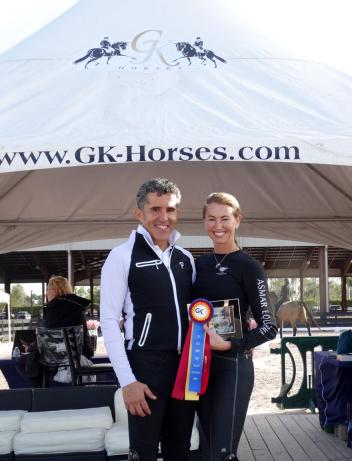 PJ Rizvi and Cesar Parra of GK Elite Sport receiving the GK Elite Adult Amateur Achievement Award during week 3 of the Adequan Global Dressage Festival.