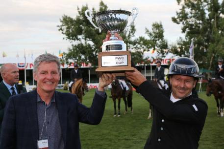 Eric Lamaze celebrates his second win on Wednesday with Cal Jacober, Office Managing Partner Western Canada, PWC.