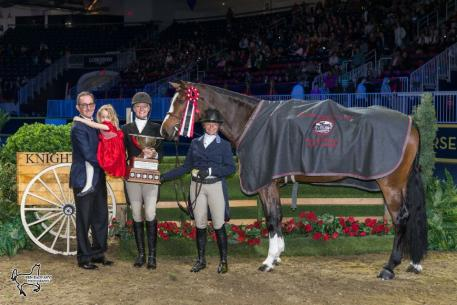 Jeff Brandmaier (left), Muffie Guthrie, and their daughter, Liza Jean, presented Erynn Ballard and Enchanted with the Lorna Jean Guthrie Challenge Trophy for the Canadian Hunter Derby Champion
