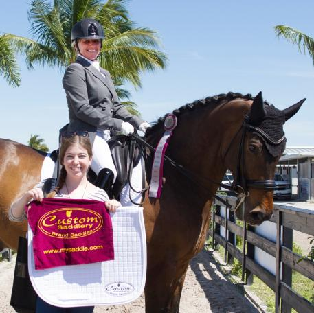 Evi Strasser, riding Rigaudon Tyme, wins the Custom Saddlery Most Valuable Rider Award at the Adequan Global Dressage Festival.