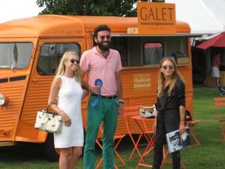 Judges Ashley Cline (left) and Mary-Kate Olsen (right) presented the blue ribbon for the Hampton Classic Boutique Contest to Javier Goggins, one of the owners of Galet.  (Hampton Classic photo)